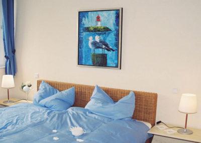 Das zweite Schlafzimmer mit Flatscreen und Bad en suite.