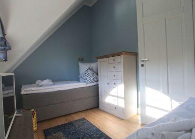 Das vierte Schlafzimmer ist mit zwei Einzelbetten ausgestattet.